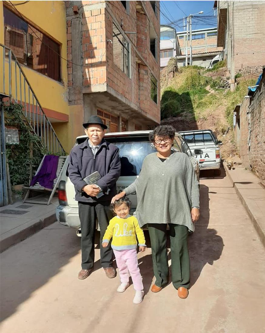 Pastor Leopoldo, Jesusa and their granddaughter.