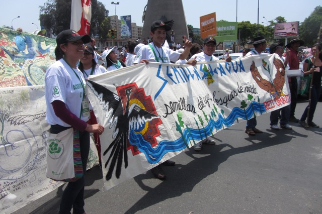 """Youth on a trip to Lima, Peru, participate in the People's COP +20 March (2014). Their banner says """"Seeds of Water."""""""