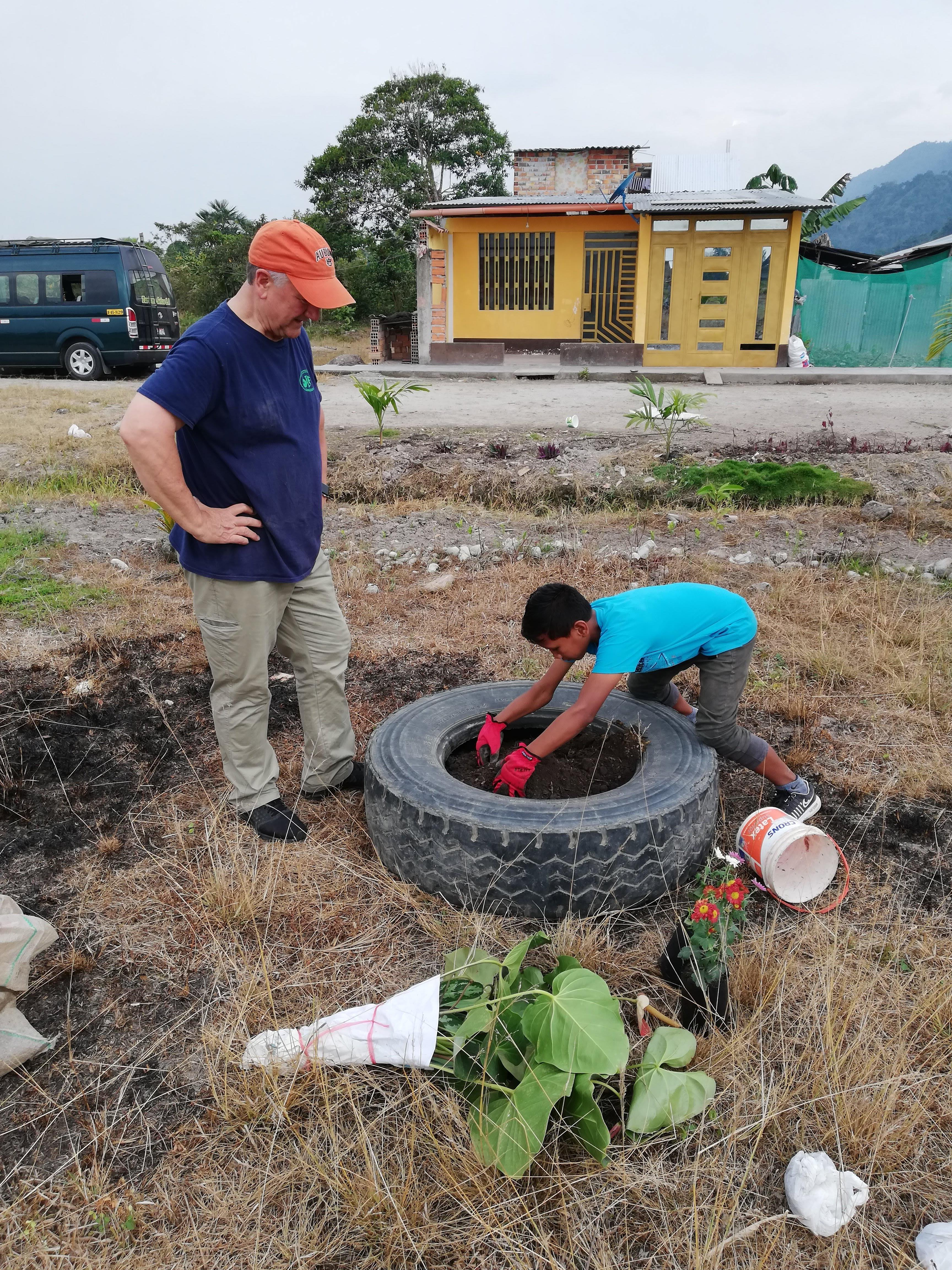 Miguel demonstrating his planting skills to Pastor Ron Shive.