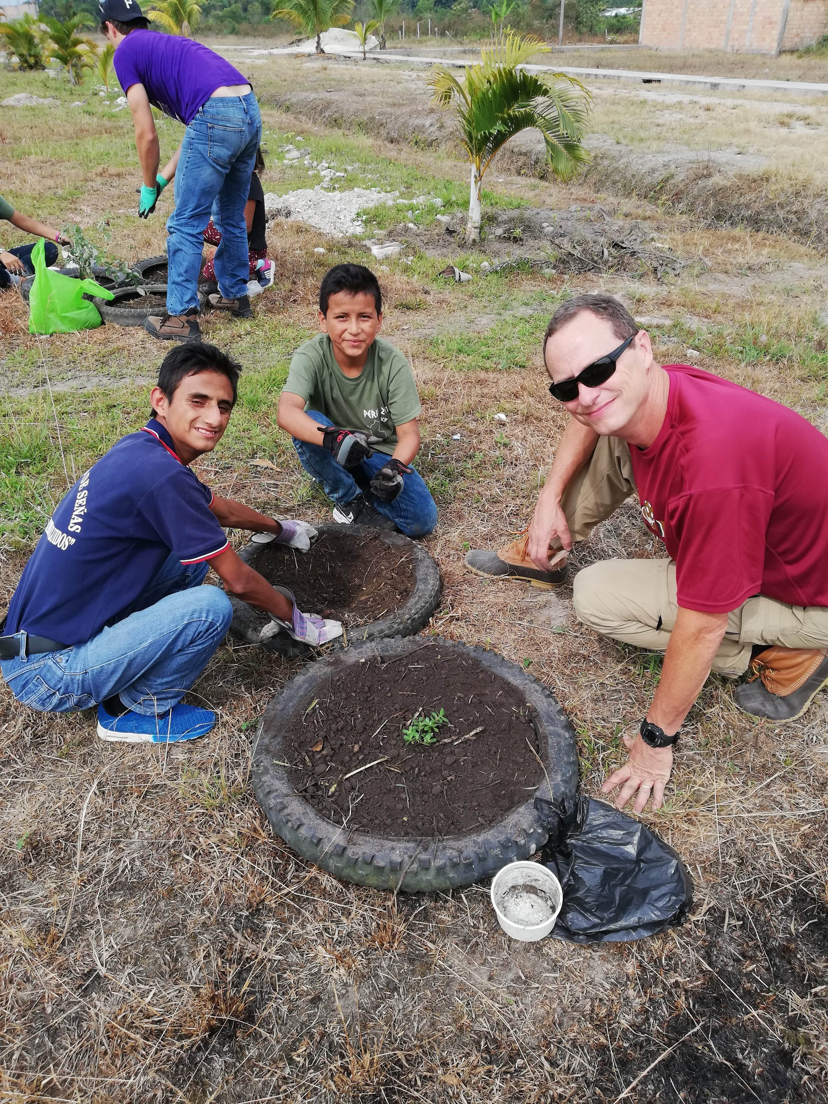 Avery and students enjoying their time together while planting.
