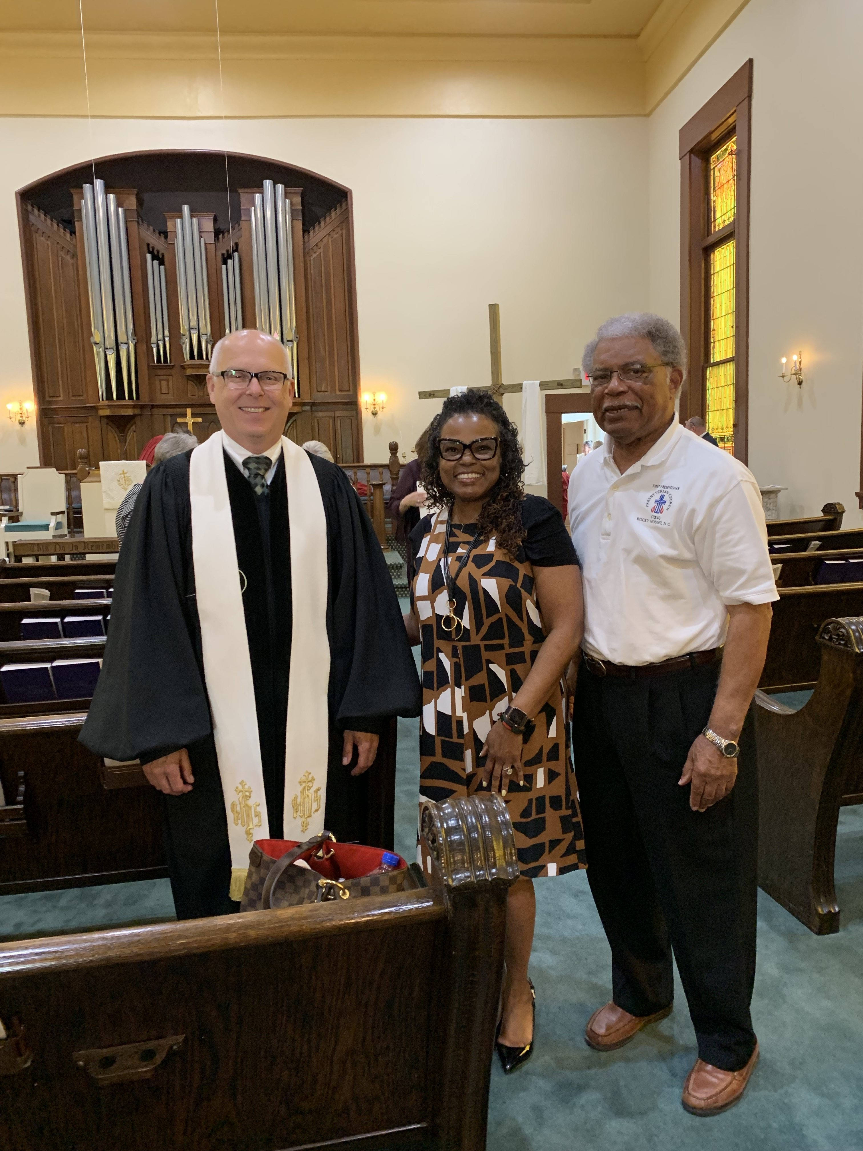 Cheryl Barnes and long-term volunteer John Etheredge with Pastor Scott Hookey at Madison Presbyterian Church in Madison, Indiana.