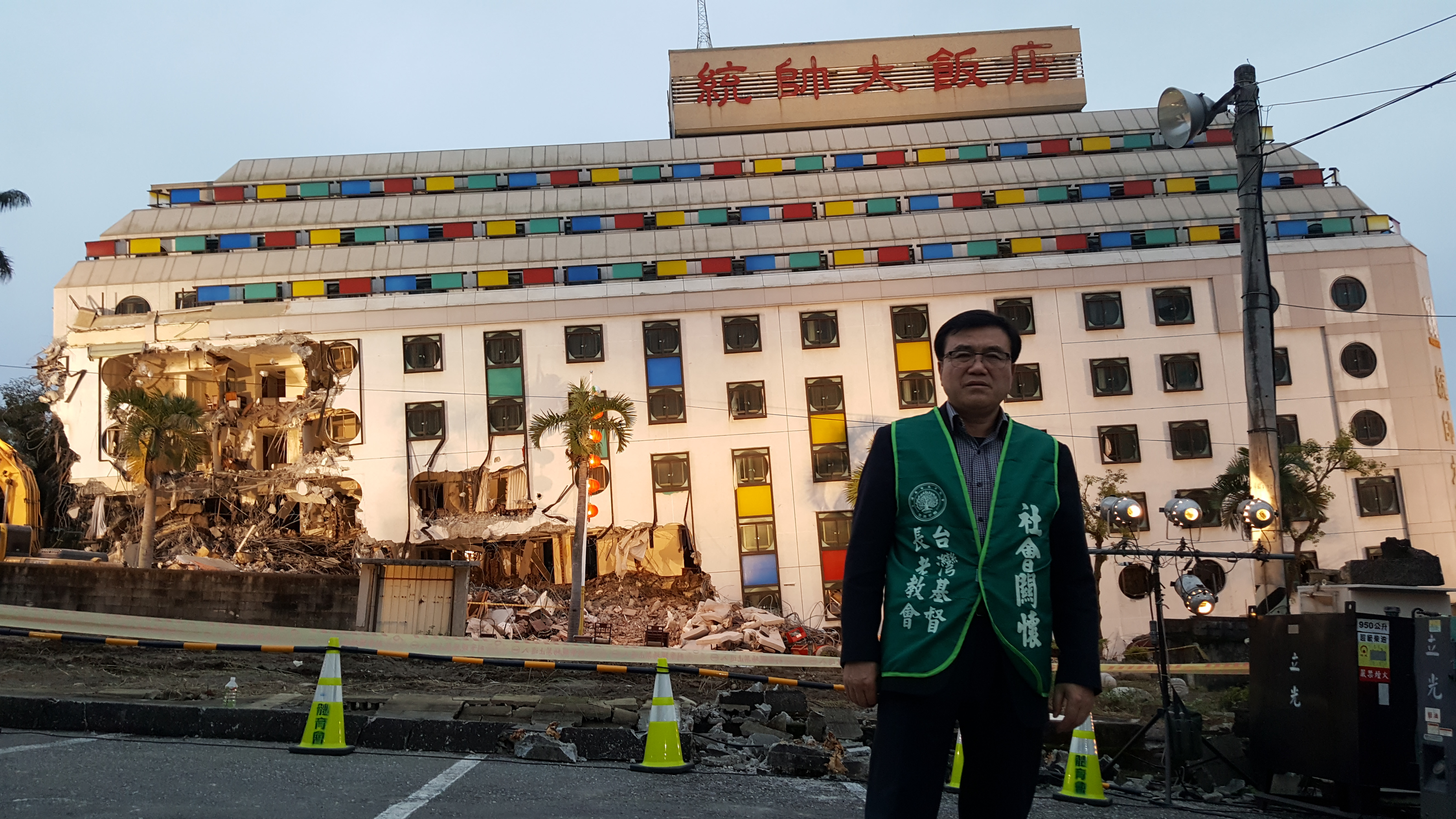 In front of the Marshal Hotel (we see only 6 floors of the 10-floor building).