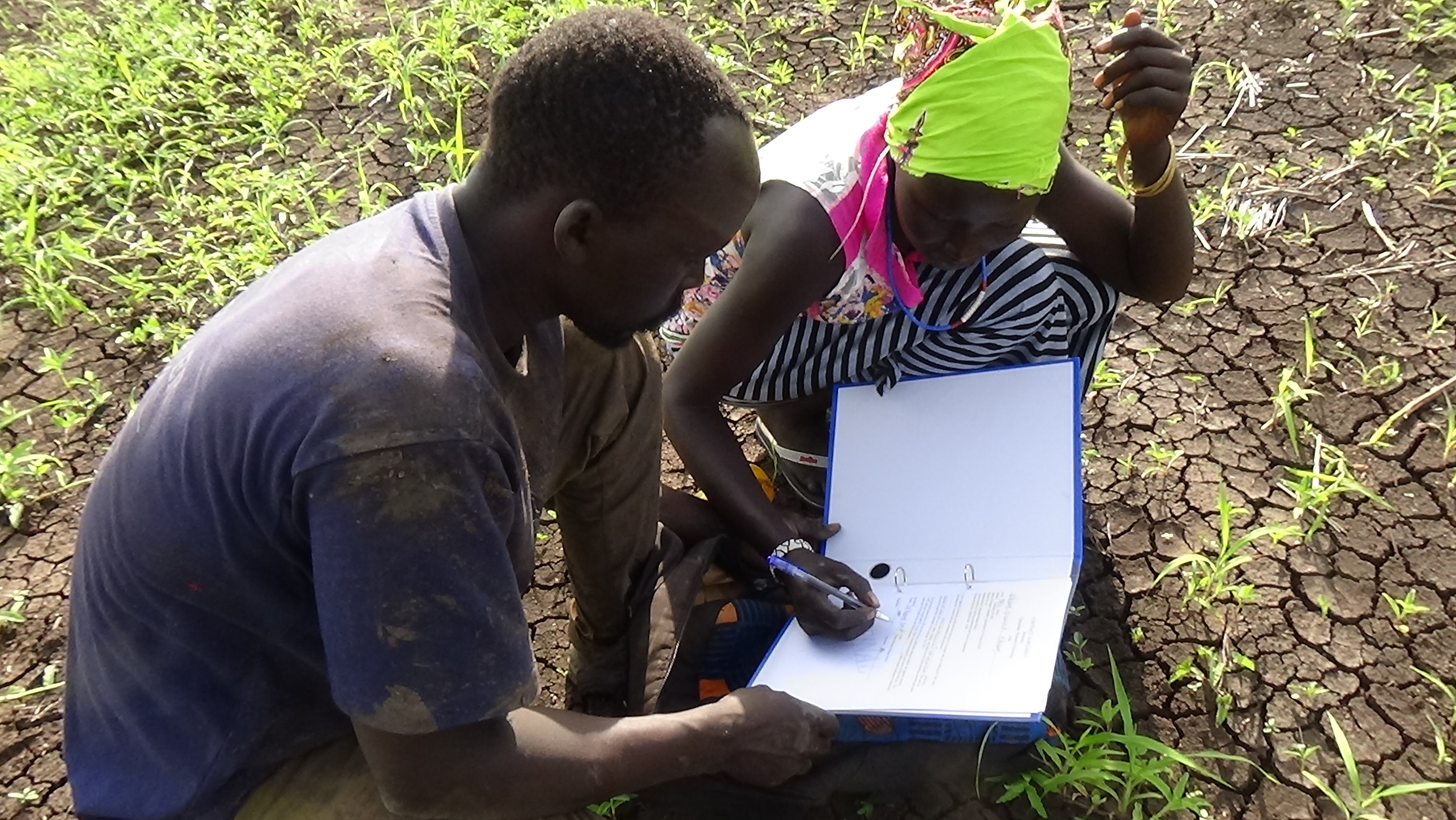 One of the farm's cooks signs to receive her wages.