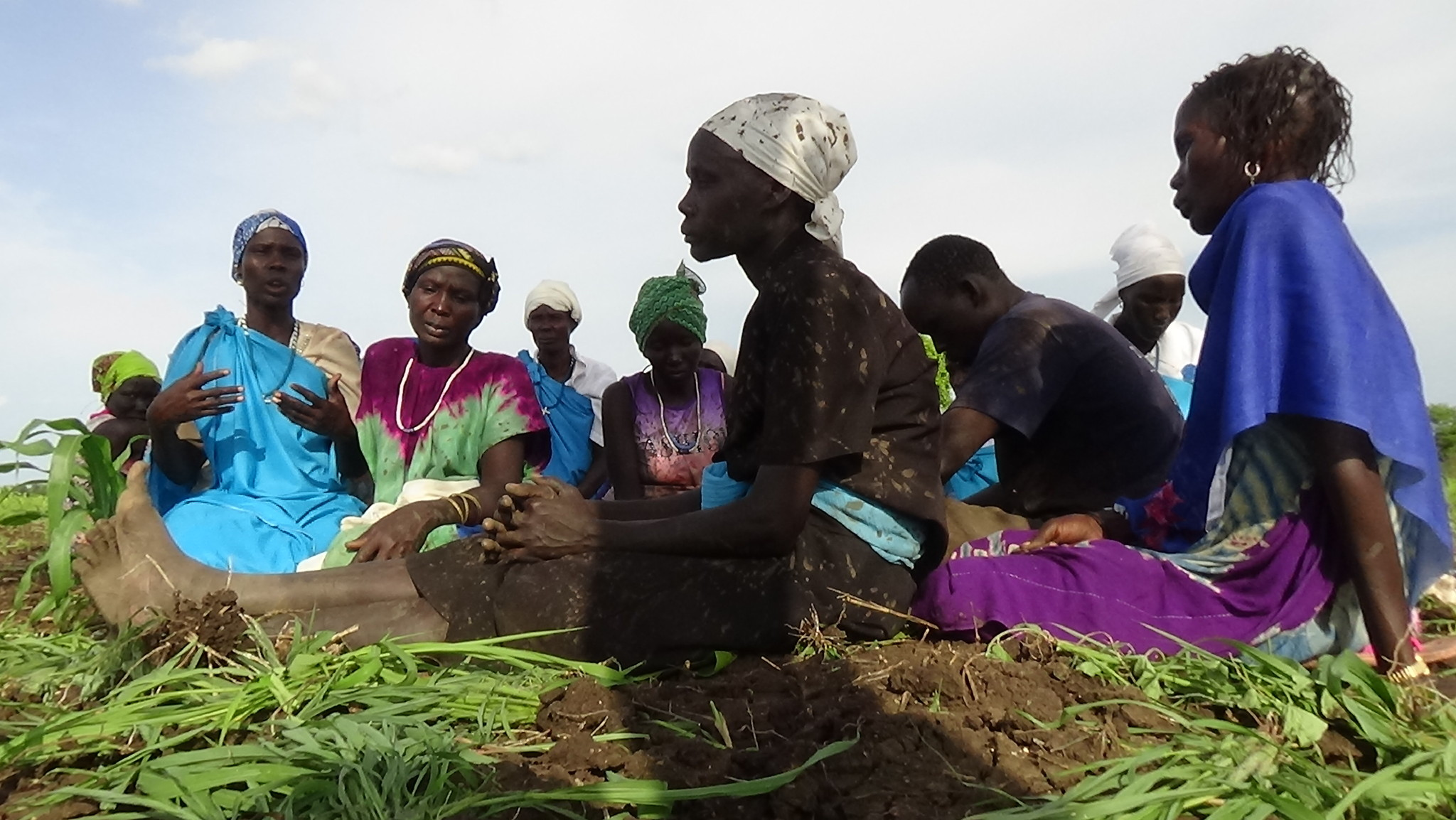 As chairwoman of the PCOSS Women in Pochalla, Mrs. Akwata Obang Okello (far left) shares the larger vision behind the Pochalla women's agricultural project.