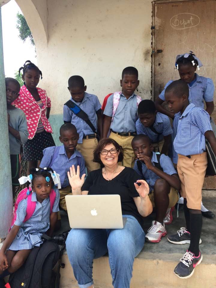 Cindy Corell in happier times, with students of St. Jacques Episcopal School, Boïs Brule, Haiti, on the island of La Gonave. January 2018.