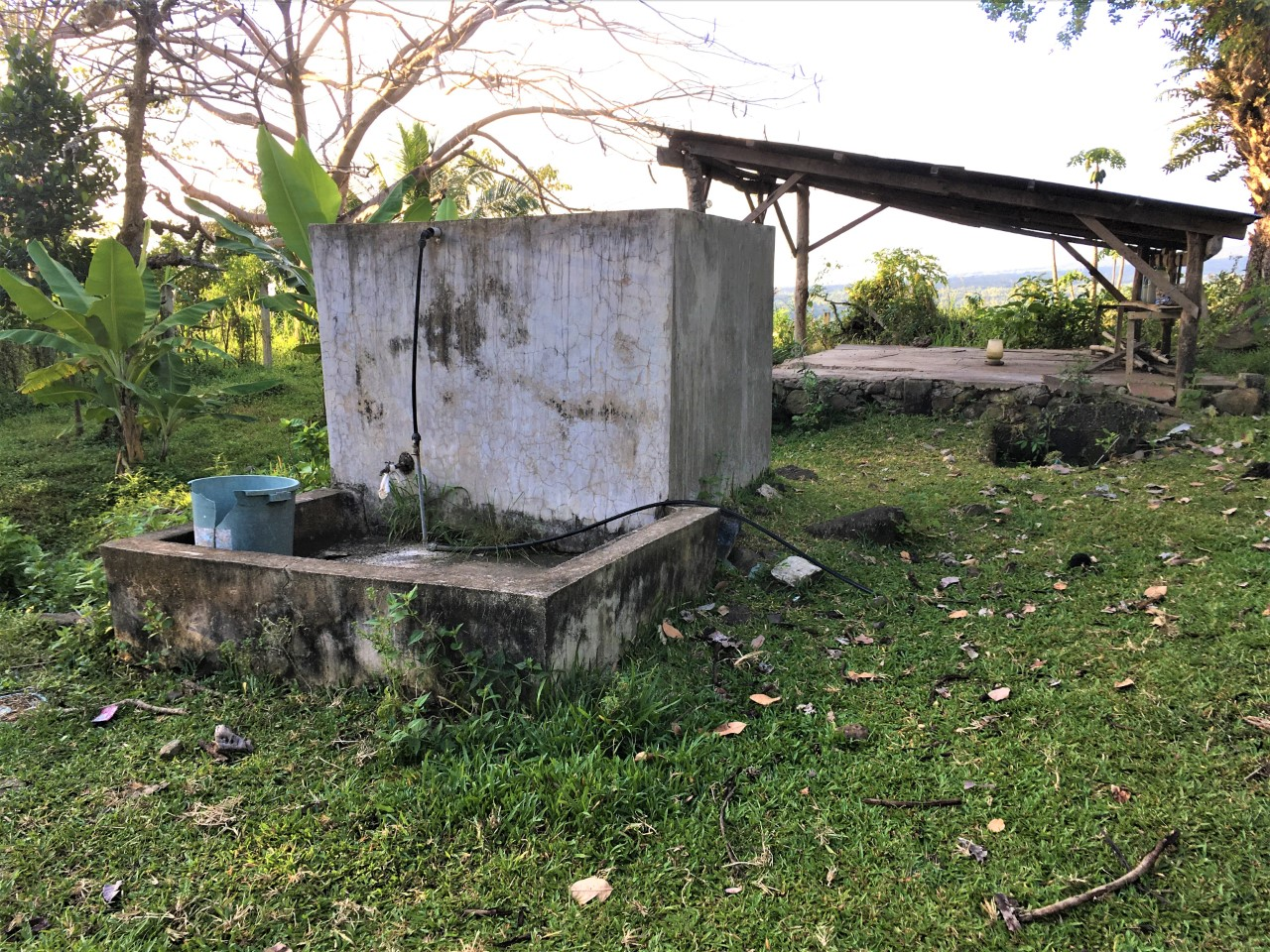A common cement water box that fills with rainwater serving the community of Balili, Negros Oriental. (Photos all by permission of subjects and photographer: Cobbie Palm.)