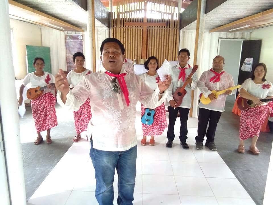 The church music team performs inside the church.