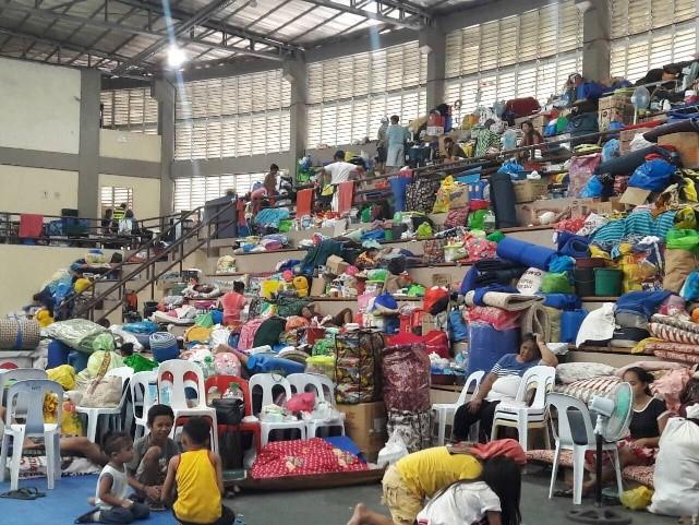 Evacuees at the ECAC facility.