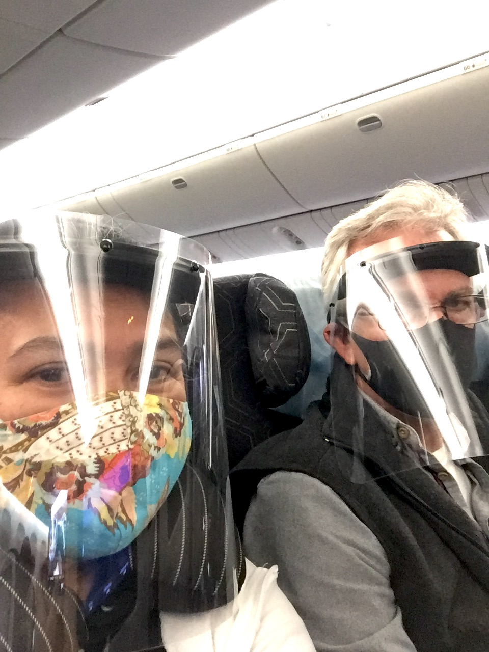 Dessa and Cobbie Palm traveling with double mask and face shield