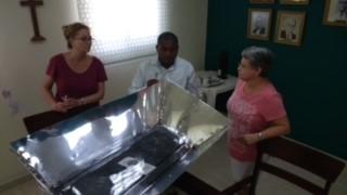 Solar oven ministry demonstration with Rev. Erasme.  Evangelical Dominican Church, Santo Domingo, DR