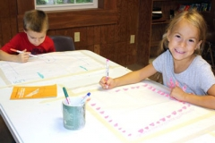 Crafton Heights United Presbyterian Church in Pittsburgh decorate a communion cloth at a recent family retreat. (Photo provided)