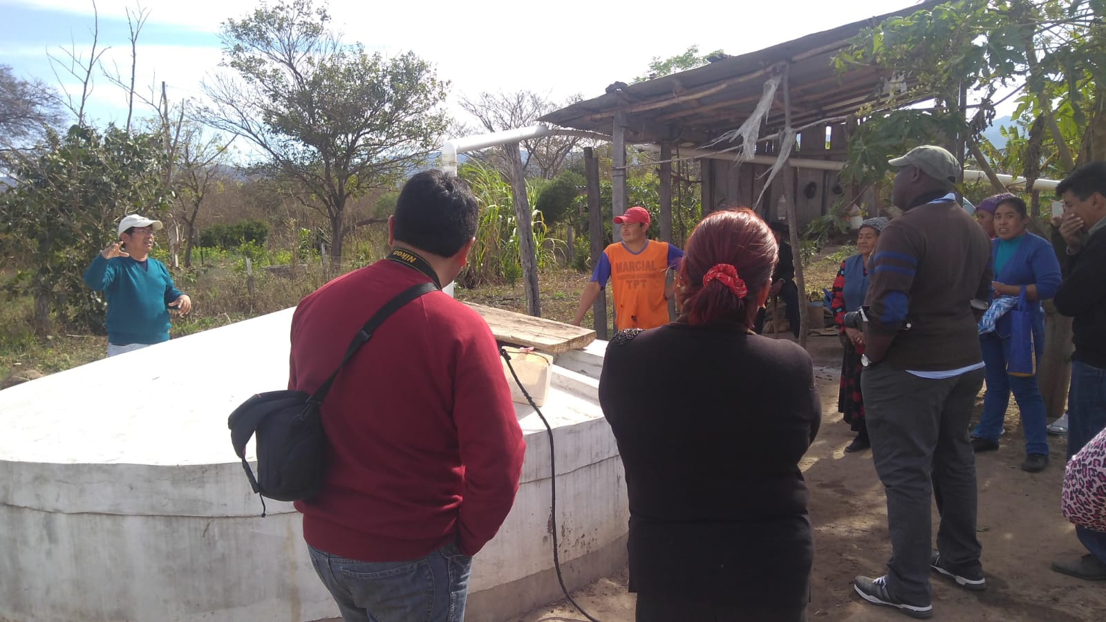 Valery Nodem of the Presbyterian Hunger Program learns about a rainwater harvest system.