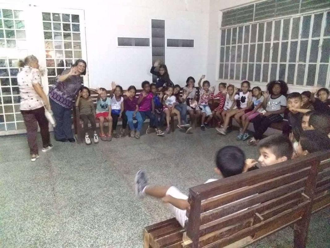 Rev. Miriam Bracho with neighborhood children at First Presbyterian, Maracaibo. Photo credit, Moisés Laguna