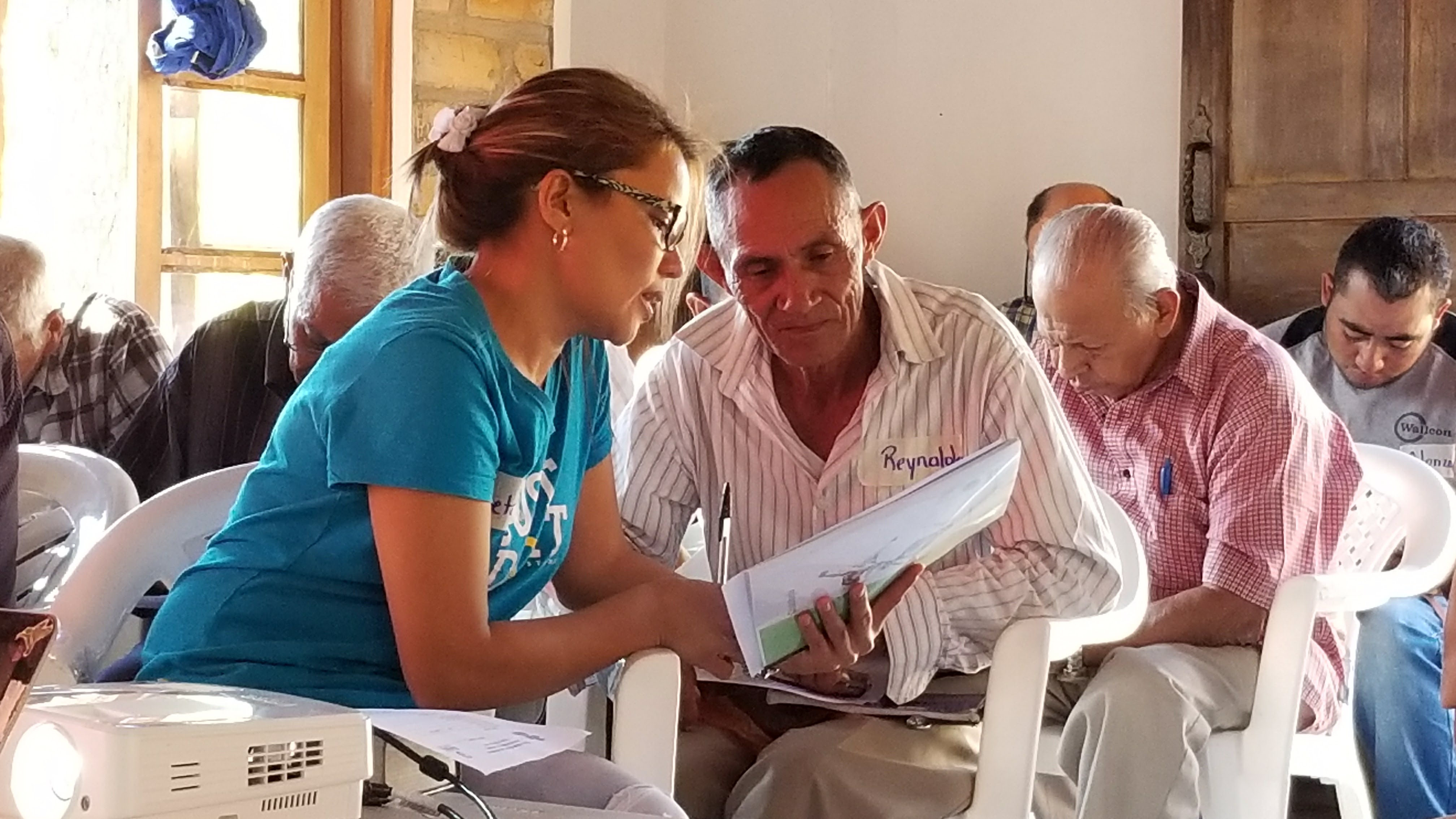 Betsabé Reyes works with pastoral education student Reynaldo Hernández, who is a farmer and pastor in a rural church.