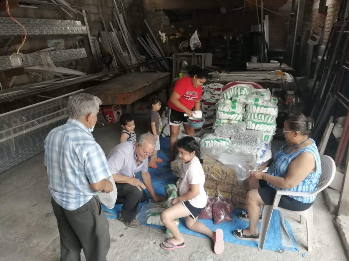 The Rodas-Samayoa family, because of social distance mandates, worked alone to assemble 250 bags of emergency food assistance for Presbyterian families. (Photo: Alex Rodas)