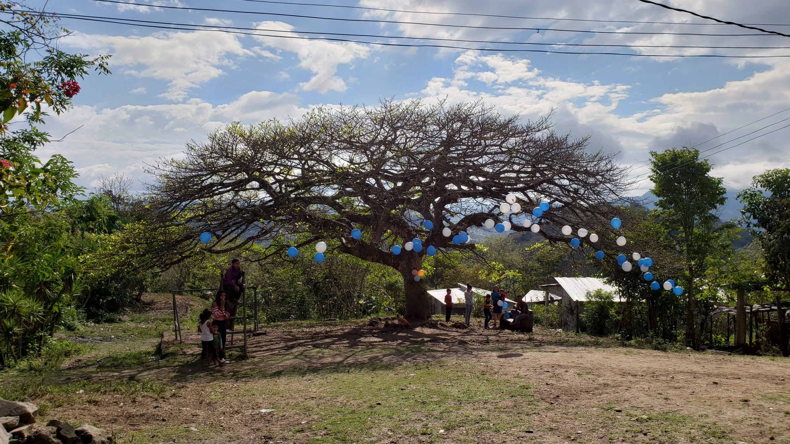 In a village near Trinidad de Copán, a large tree shades the community playground and gathering place that were developed and built in partnership with U.S. Presbyterians.