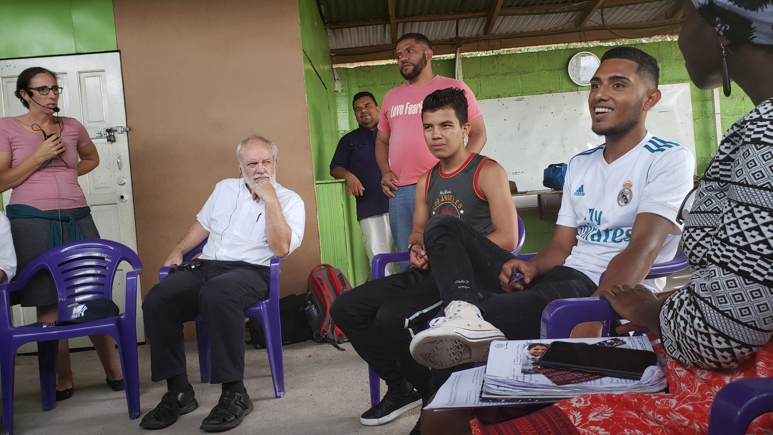 """Presbyterian Church visitors (from left) Tracey King-Ortega, Chris Iosso and Alexander Rodas met with participants in a youth development center in the neighborhood of Nueva Suyapa, Tegucigalpa, Honduras. The youth and their mentor spoke of their desires to be """"agents of change"""" in their neighborhoods, to study at university and to support their families."""