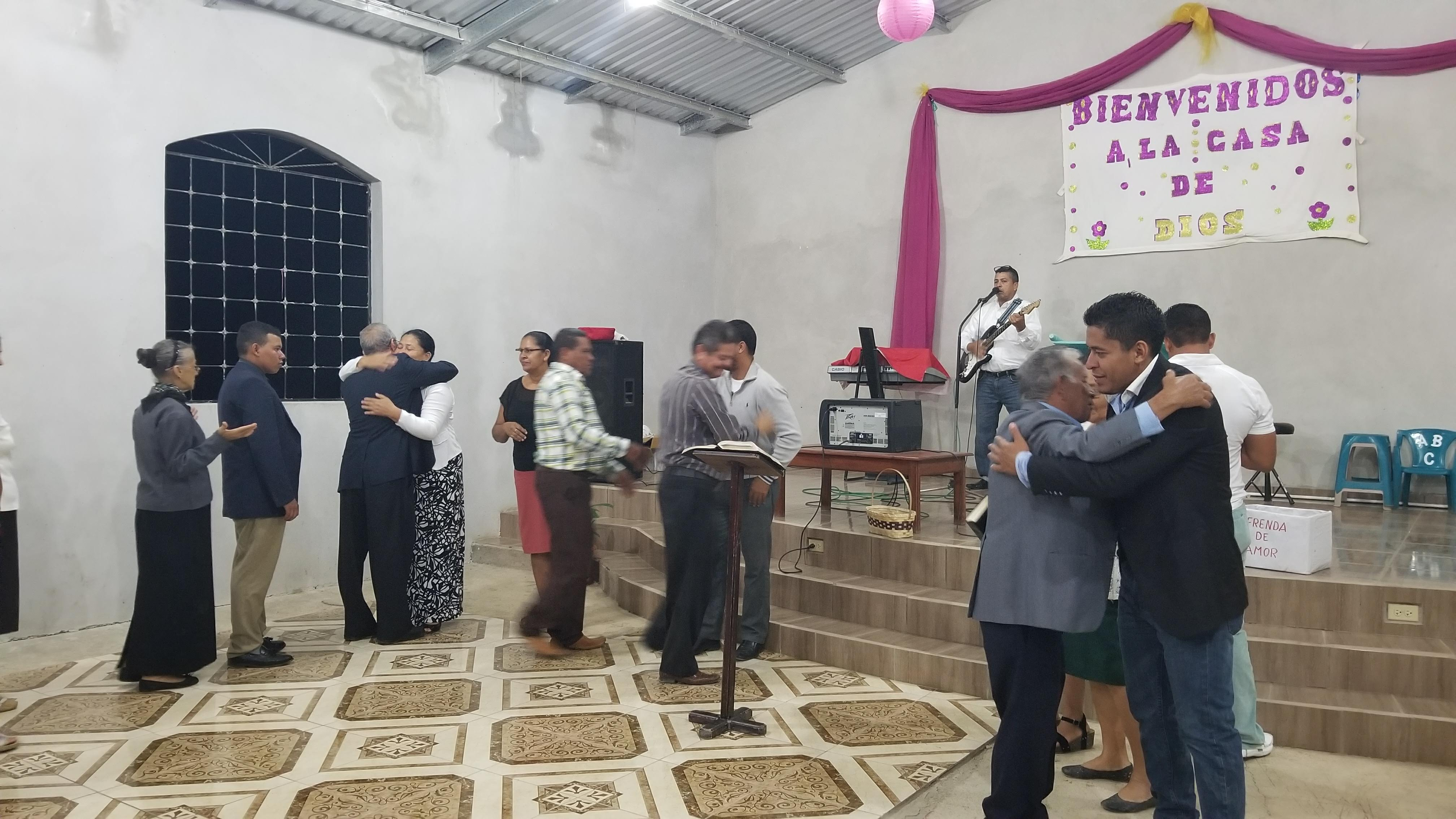Greeting newly ordained deacons and elders in the Presbyterian church at Guatemalita.