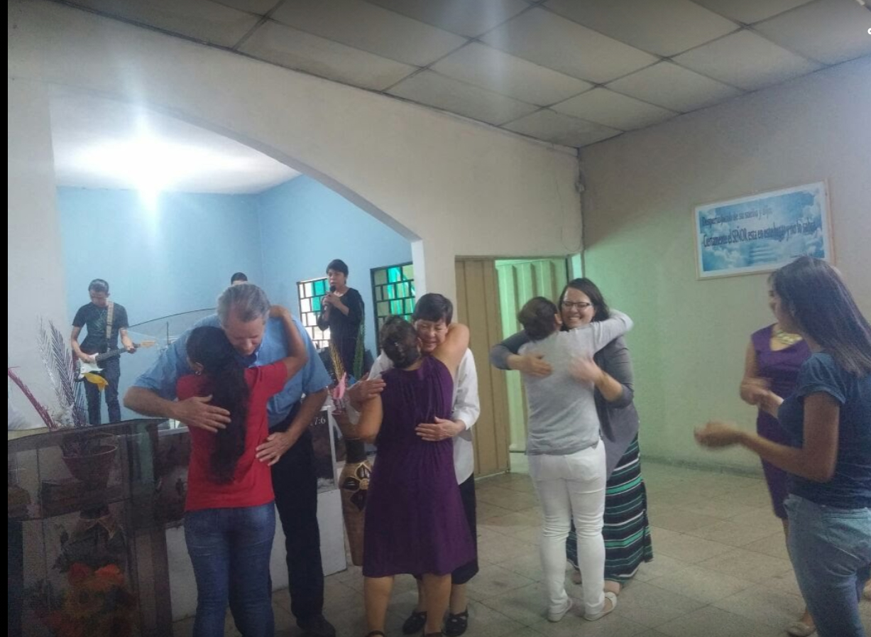 I have looked back over my three years' worth of photos in Honduras and been touched by so many memories of hugs, large group gatherings, and physical closeness. Here, my parents and I were welcomed at a church service during the first week after I moved to Tegucigalpa. Every single person in the congregation hugged us.