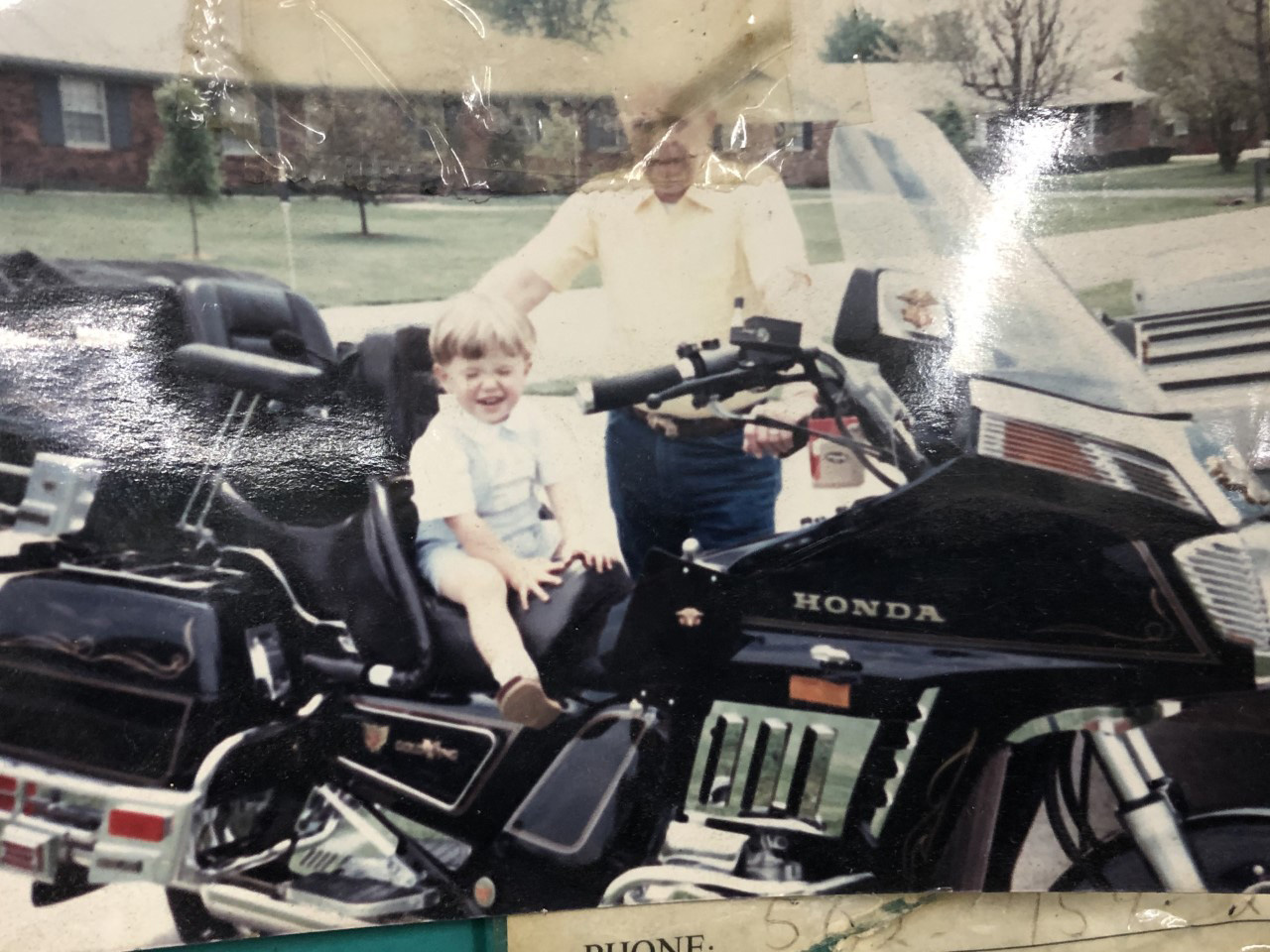 Our son, John, on John Williams' motorcycle in KY before we went to Brazil (May 1990).