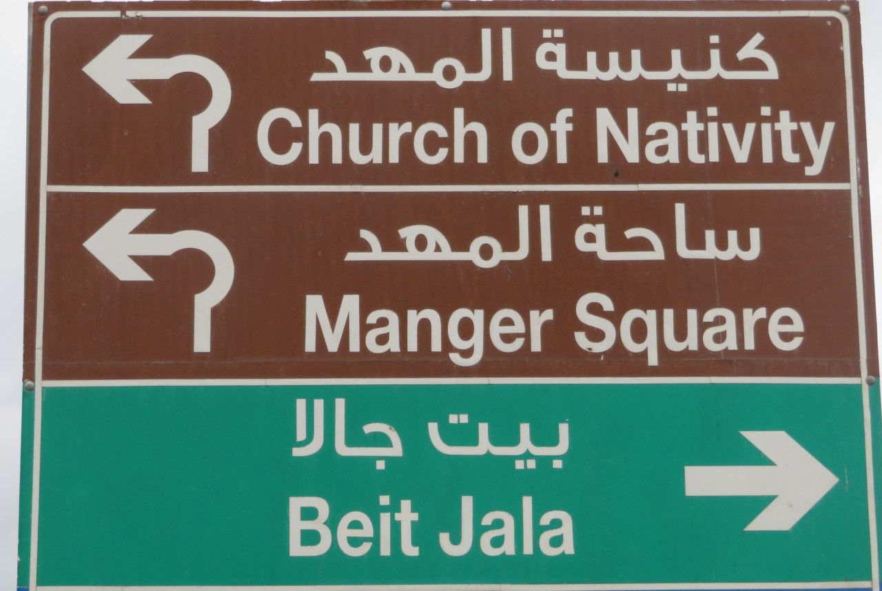 A sign points the way to Bethlehem's Church of the Nativity, but there are no tourists around that need it.