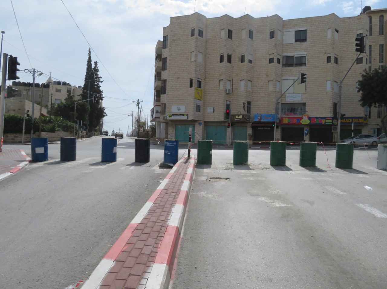 Barrels filled with liquids and/or concrete block the road leading between Bethlehem and Beit Jala.