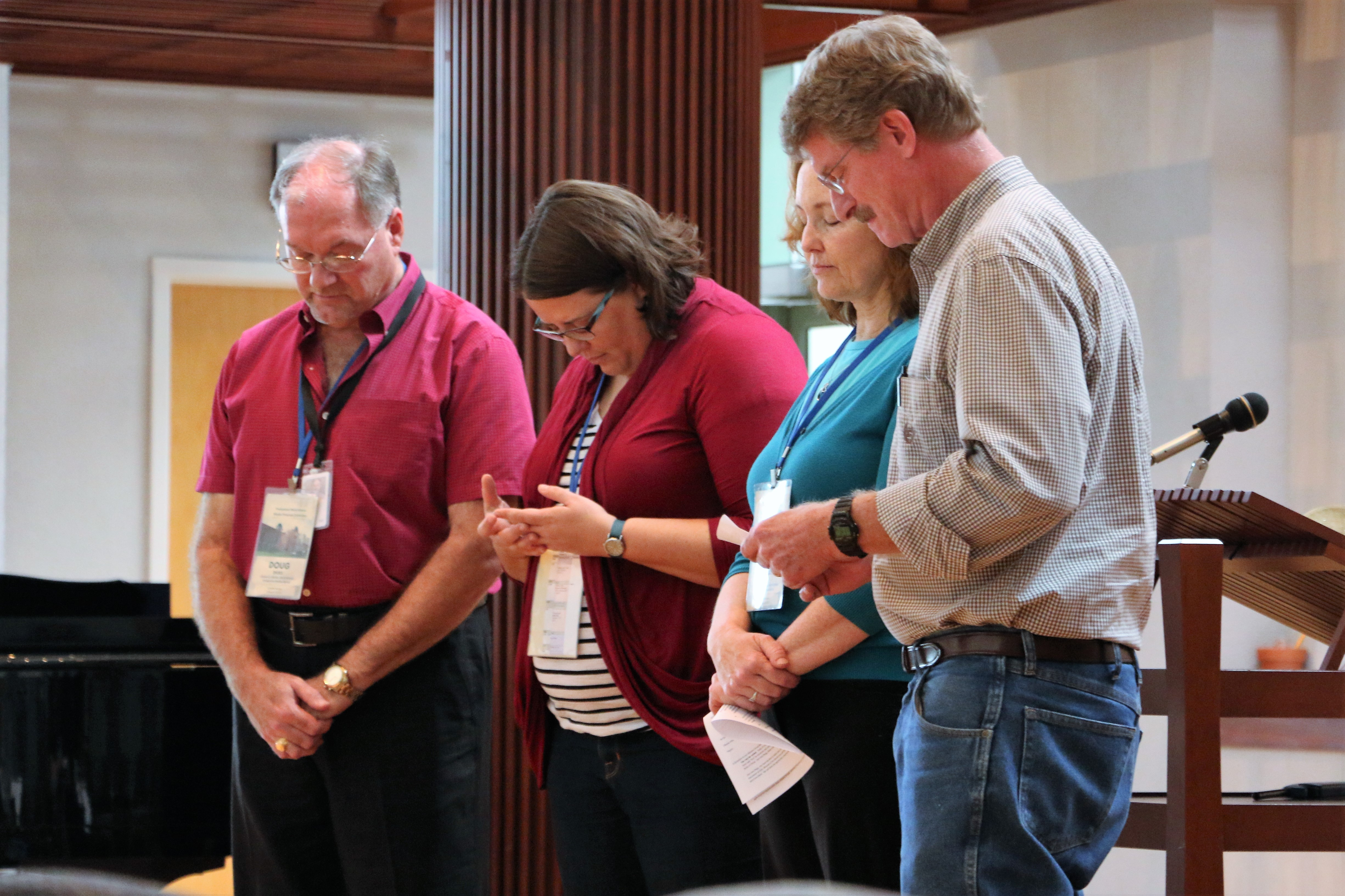 A prayer with Dori, Michelle, and Del Braaksma at the close of our Service of Blessing.