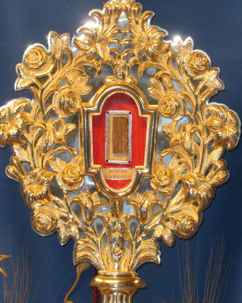 A fragment said to be of the original manger of Jesus, enclosed in a reliquary.