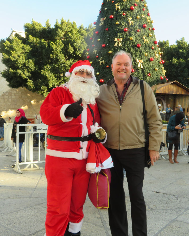 Doug shares a moment with the Palestinian Santa roaming Manger Square in Bethlehem.