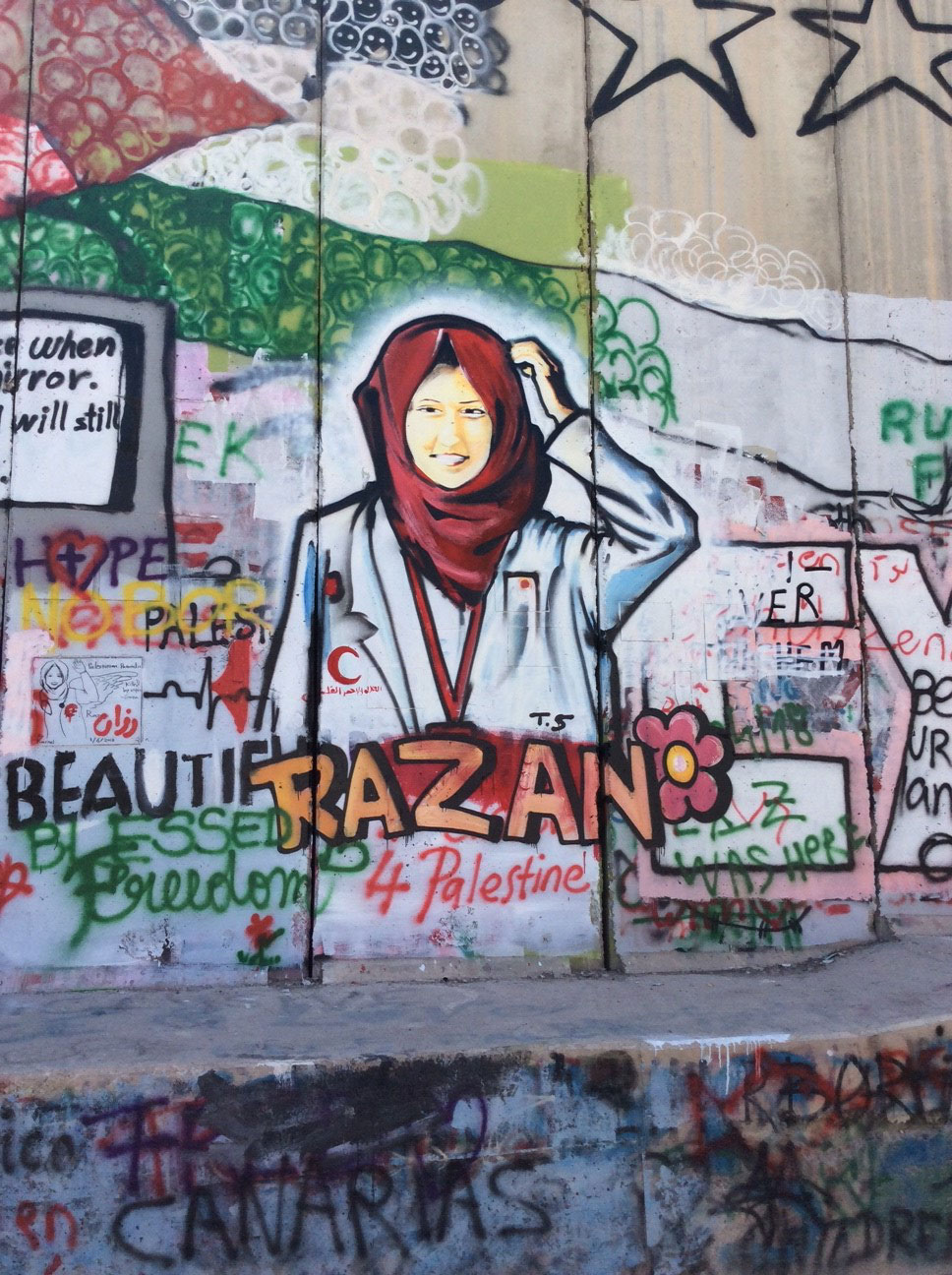 Twenty-one-year-old medical aid worker Razan al-Najjar, memorialized on Israel's separation barrier/wall in Bethlehem. She was shot dead at the border fence between Gaza and Israel on June 1.