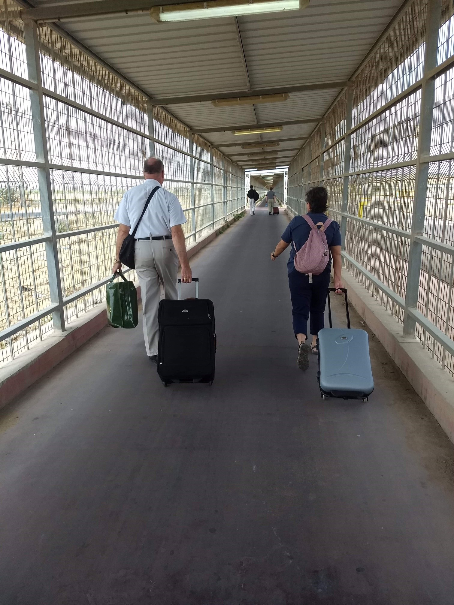 Making our way through the caged corridor walkway into Gaza.