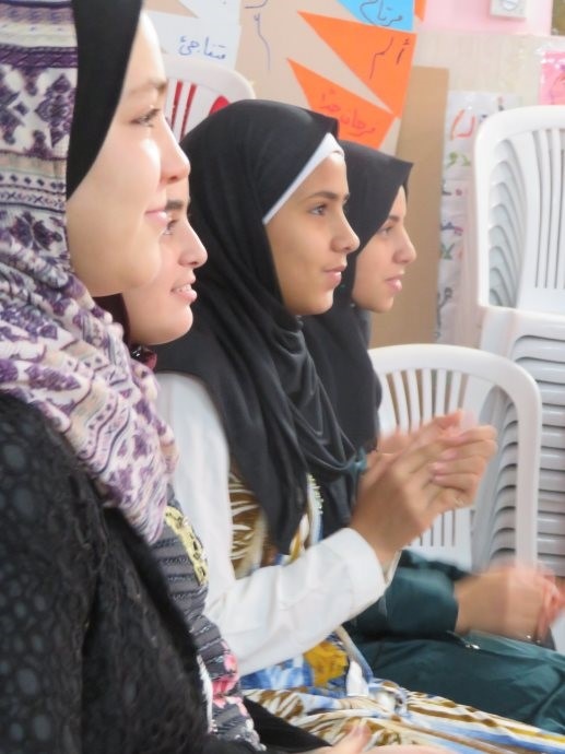 Young Palestinian women engage in psychosocial training at the Family Health Center in Darraj.