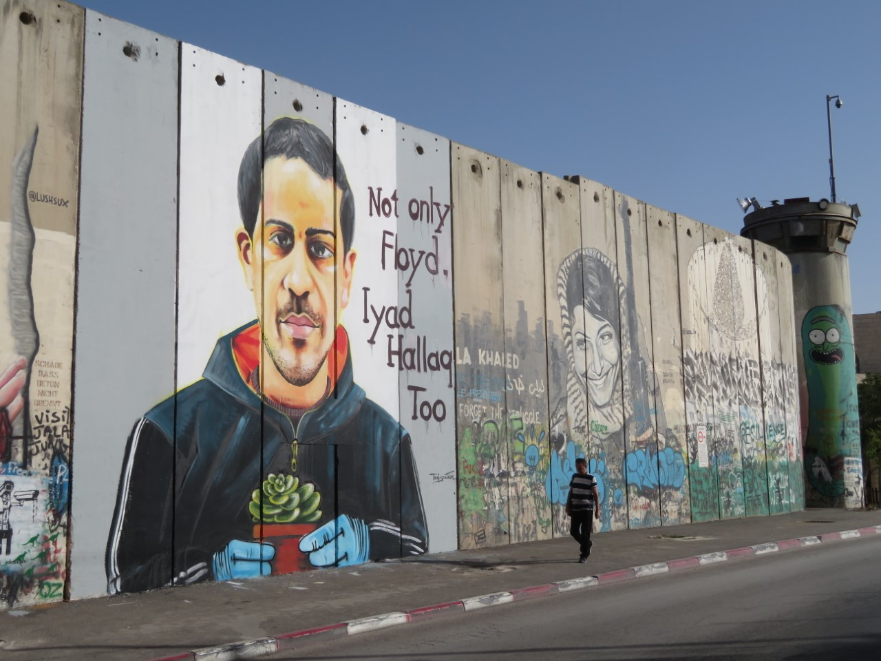An image of Iyad al-Hallaq, painted on the Separation Barrier inside Bethlehem by Palestinian artist Taqi Spateen.