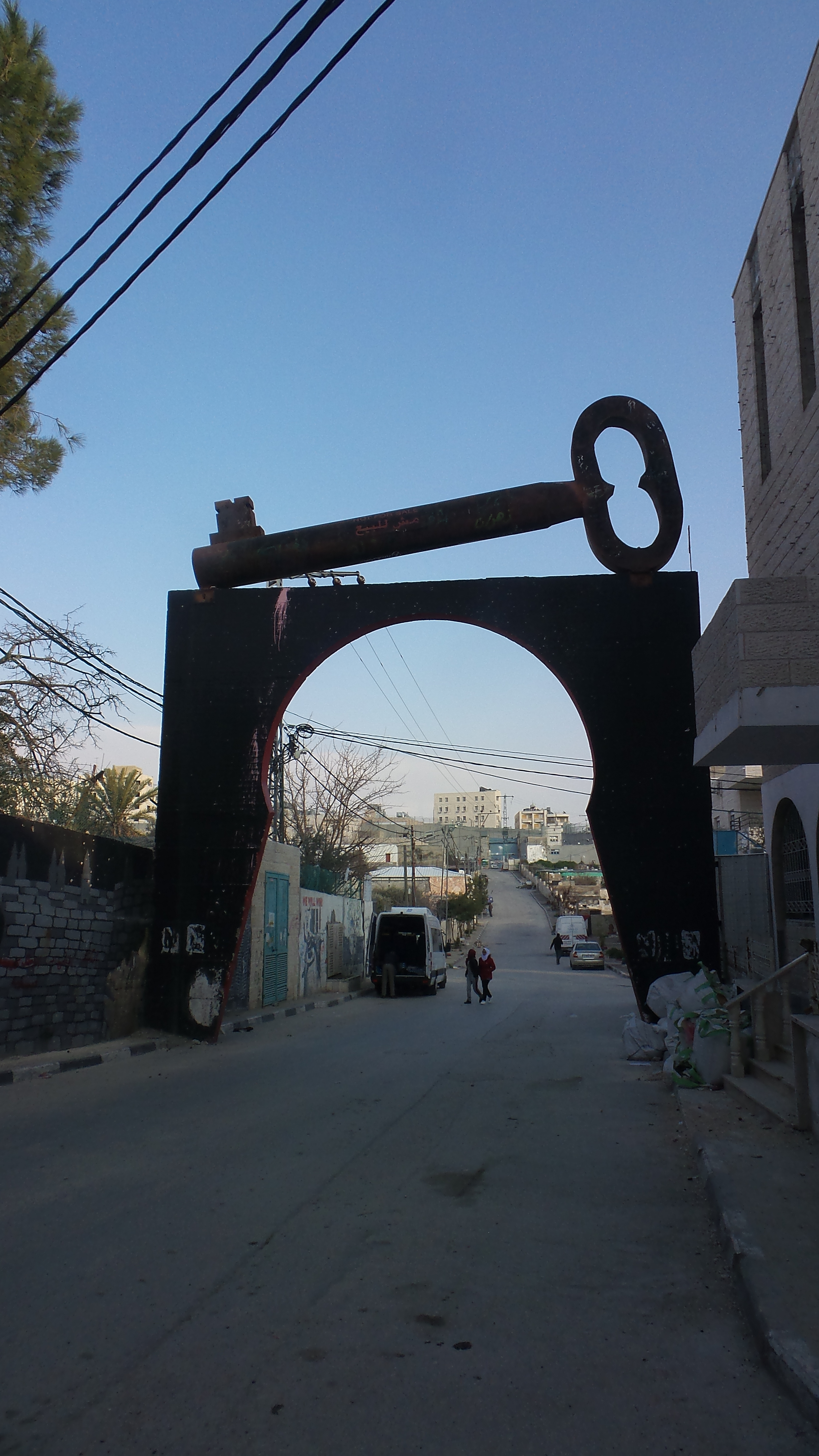 Entrance to the Aida Refugee Camp in Bethlehem. The key is a symbol of the longing of Palestinian refugees to return to their homes in what is today Israel.  Photo by Kristen Brown