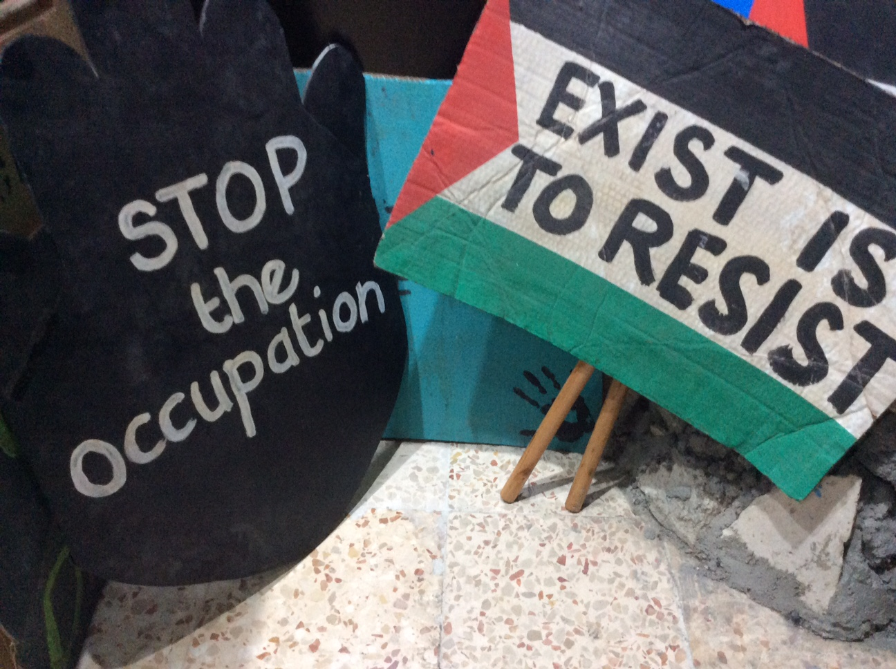 Protest signs on display at the Banksy Museum at the Walled Off Hotel in Bethlehem.