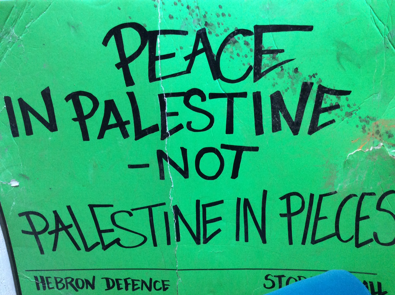 A protest sign on display at the Banksy Museum at the Walled Off Hotel in Bethlehem.