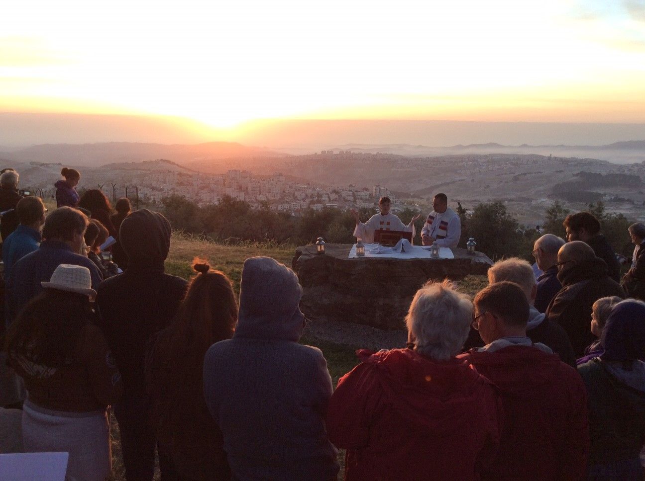 The English-speaking congregation of the Lutheran Church of the Redeemer celebrates Easter Sunday morning at a sunrise service on the Mount of Olives in Jerusalem