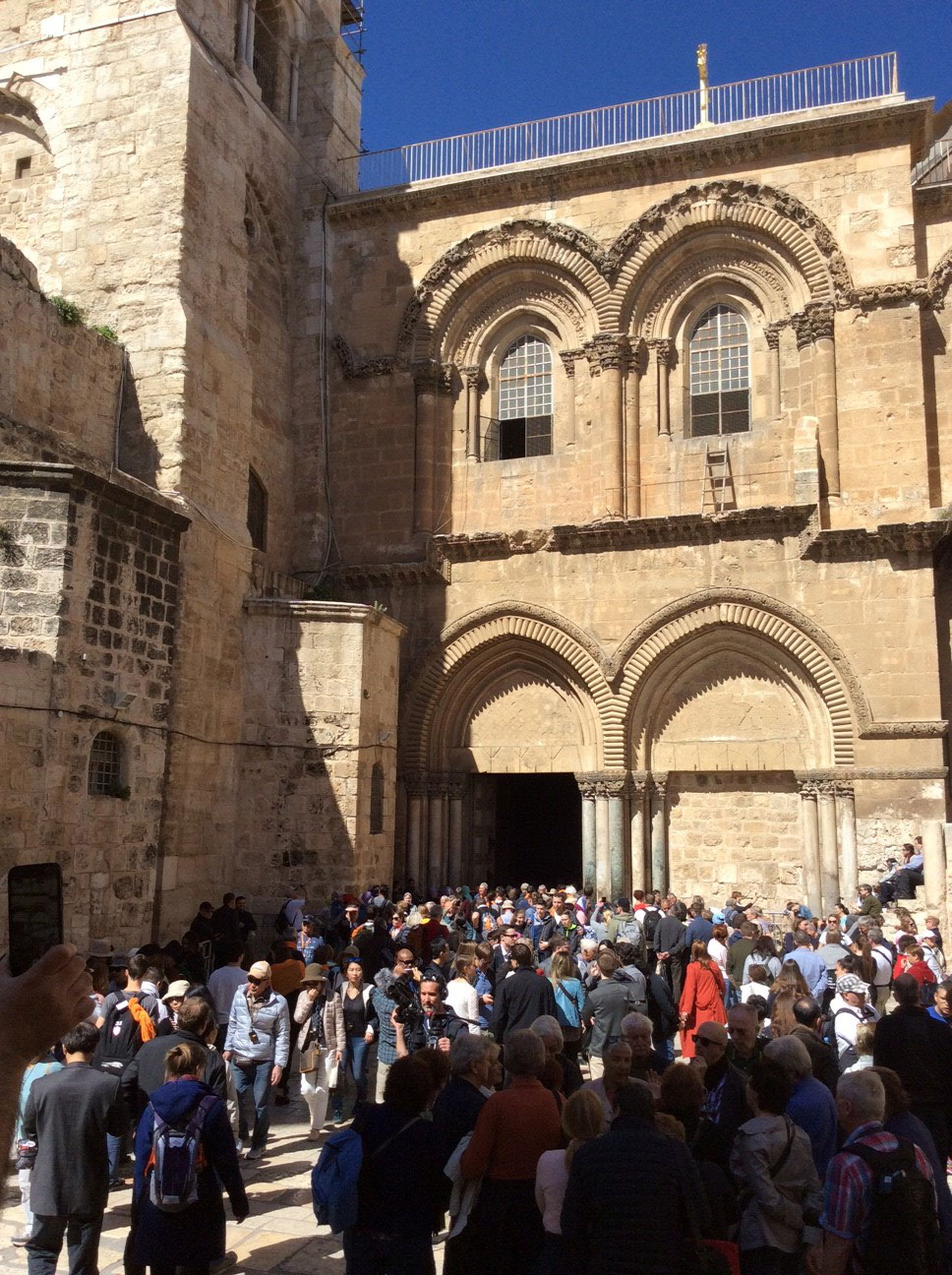 Thousands of people throng to the Holy Sepulchre Church on February 28, two days after its doors had been shut by Church leaders.