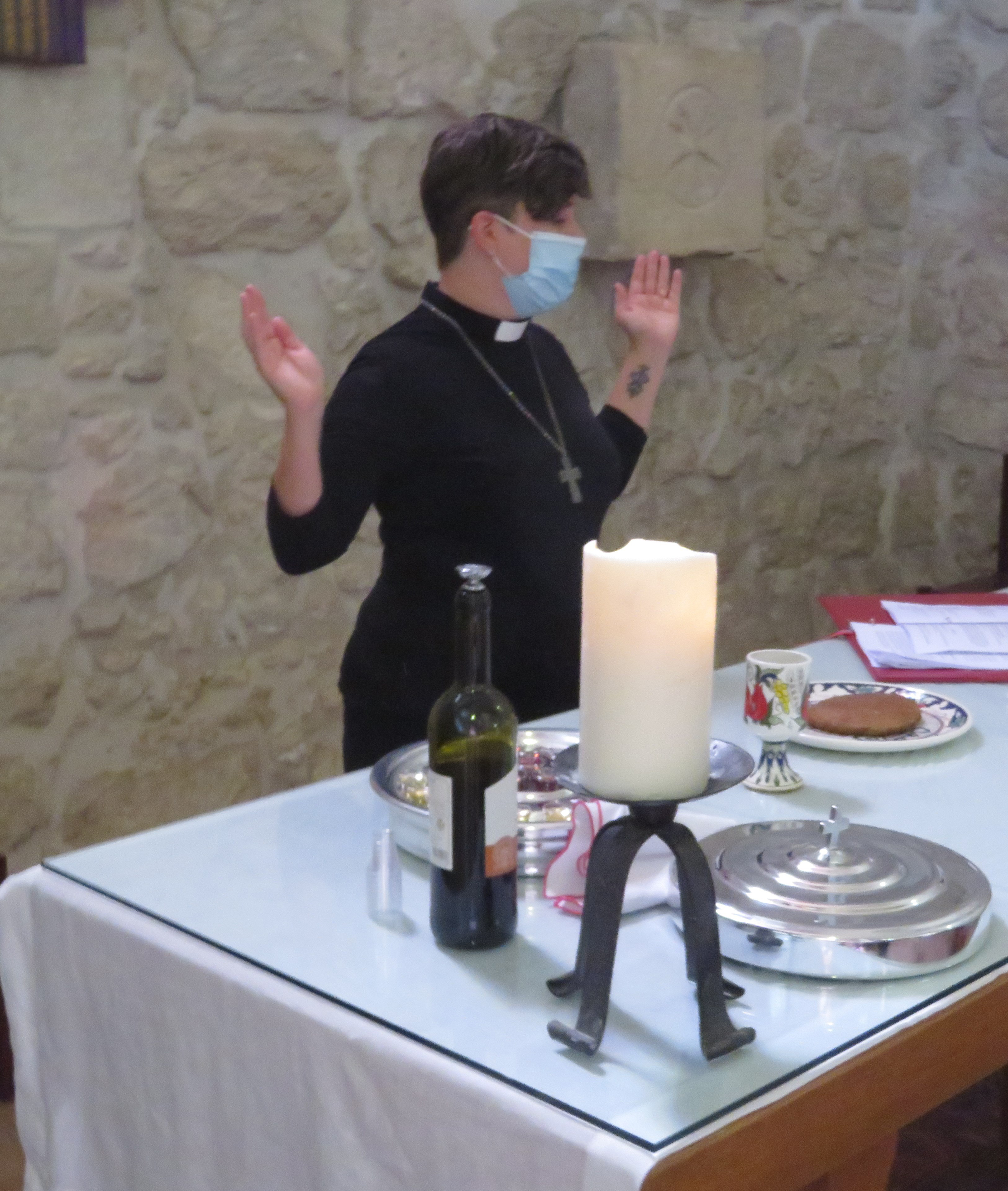 Pastor Carrie Ballenger recites the Eucharist at the Lutheran Church of the Redeemer, before lockdown.