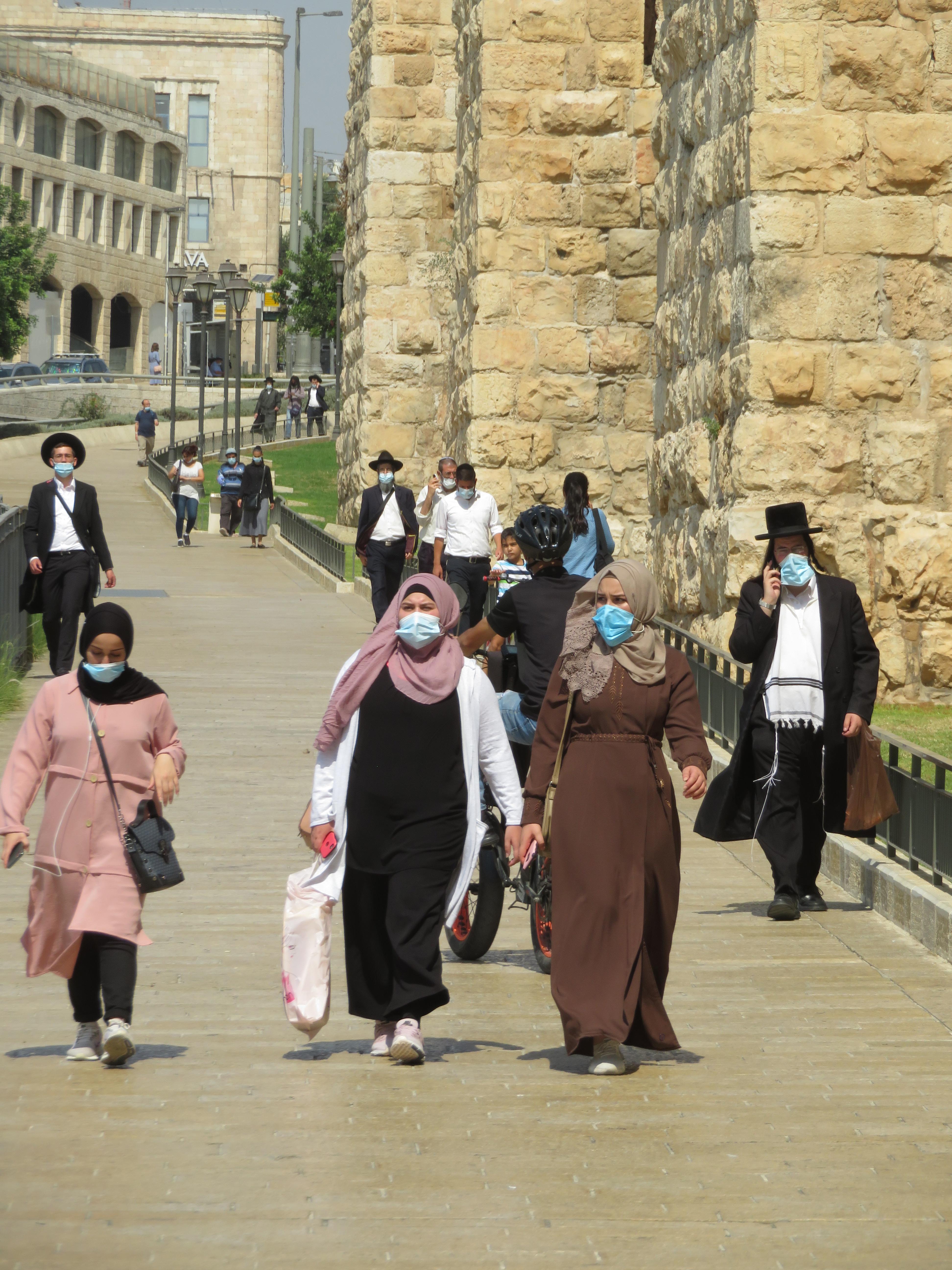 Walking in Jerusalem.  Israelis and Palestinians must wear a face mask in public or risk a steep fine in Israel.