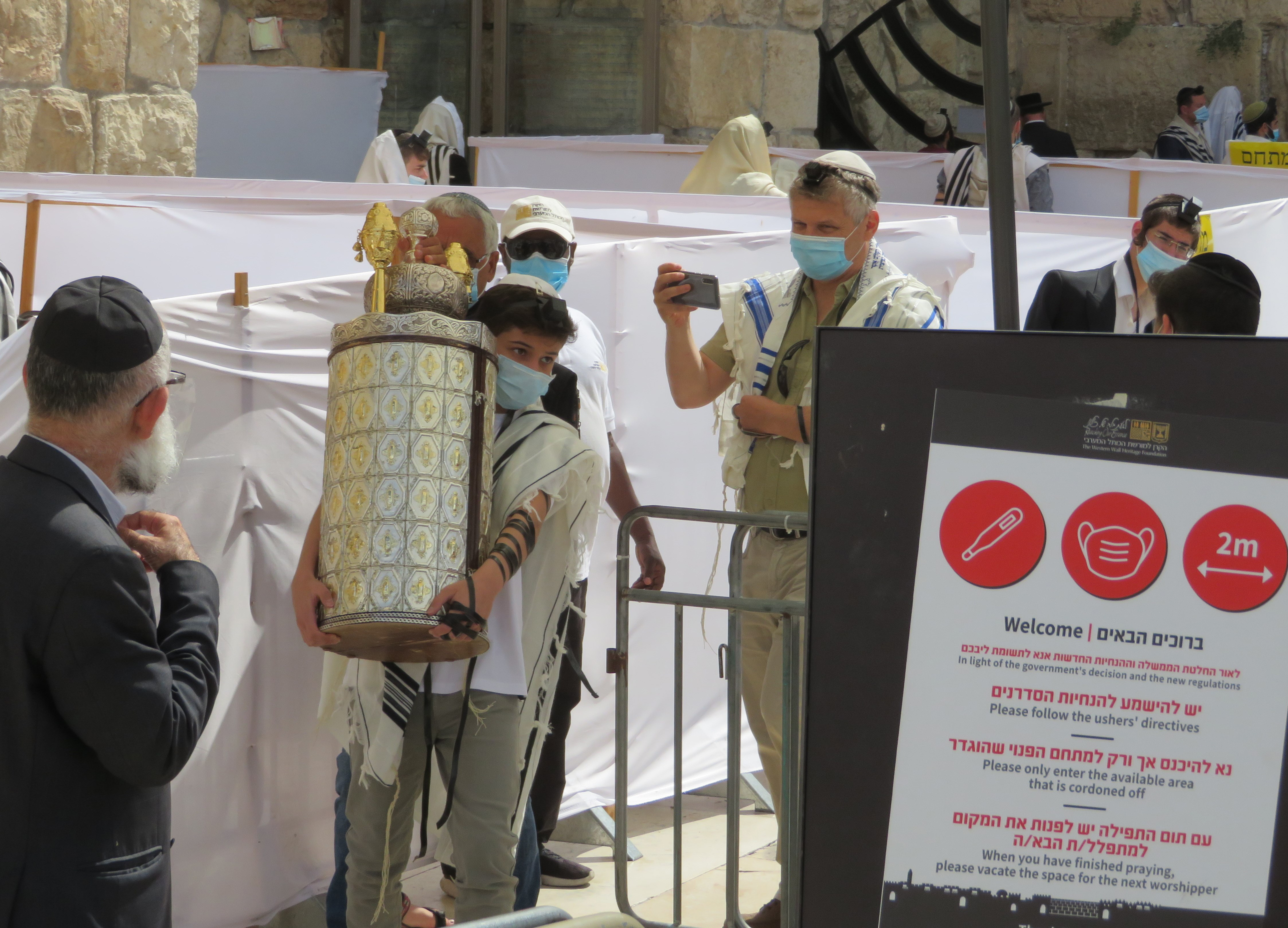 A young boy celebrates his Bar Mitzvah at the Western Wall, during COVID-19.