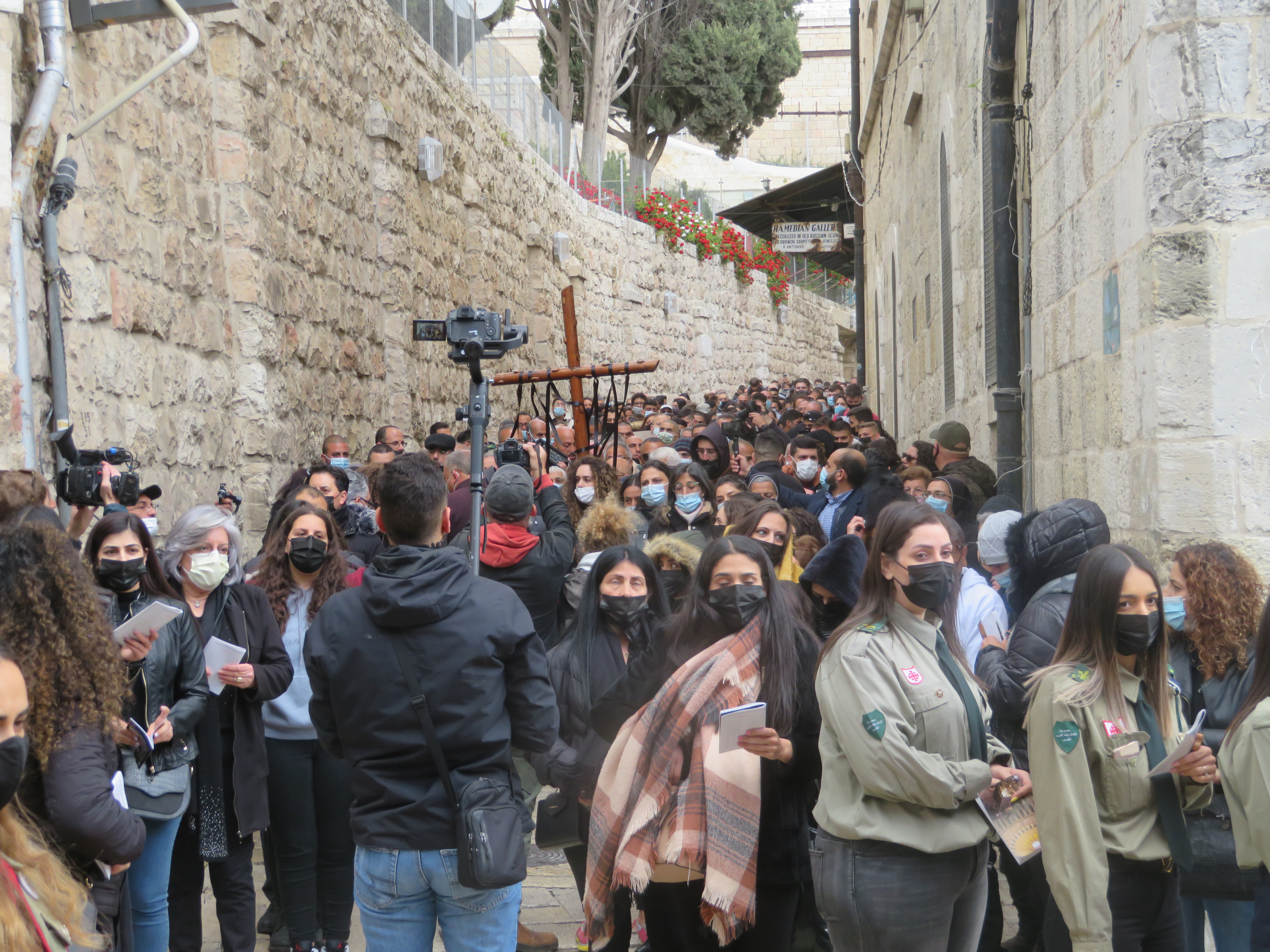 Palestinian Arab Christians re-trace Christ's journey to His crucifixion on Good Friday in Jerusalem.