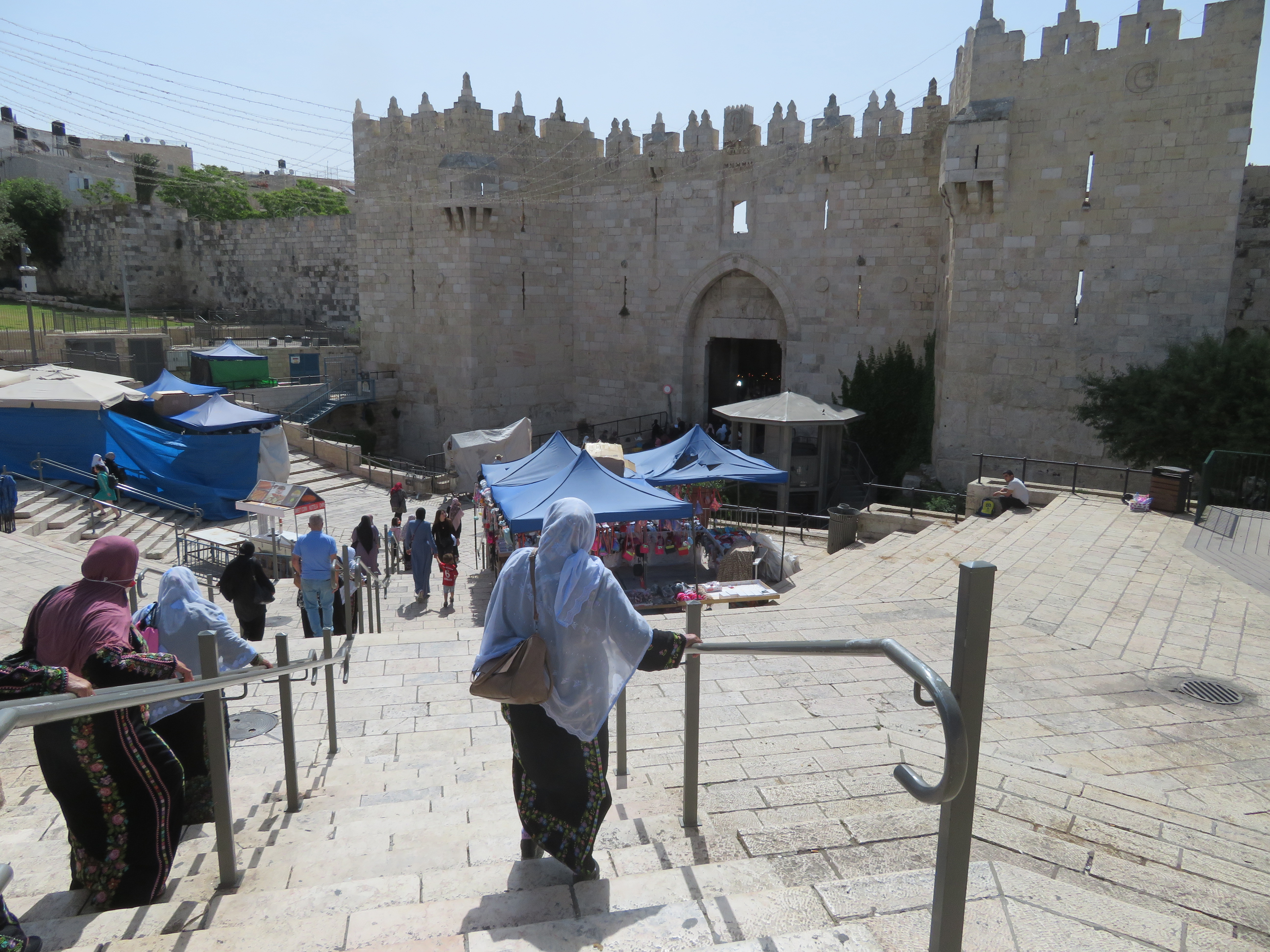 Muslim women descend the steps at Damascus Gate on their way into the Old City of Jerusalem during Ramadan.