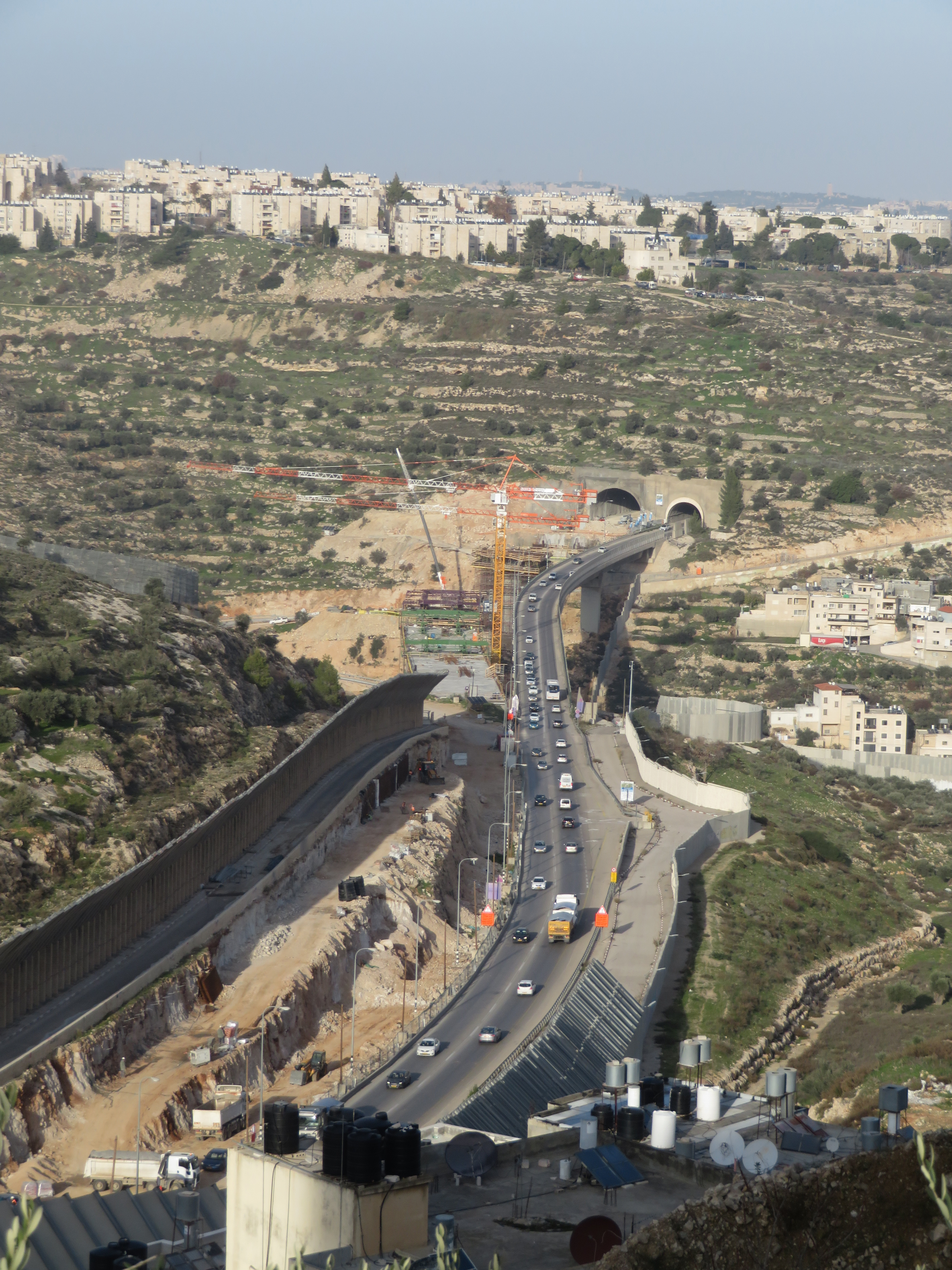 Engineering of space: A new tunnel and bridge under construction over the Cremisan Valley near Bethlehem will benefit the Israeli settler population in the southern West Bank at the expense of the Palestinian population.
