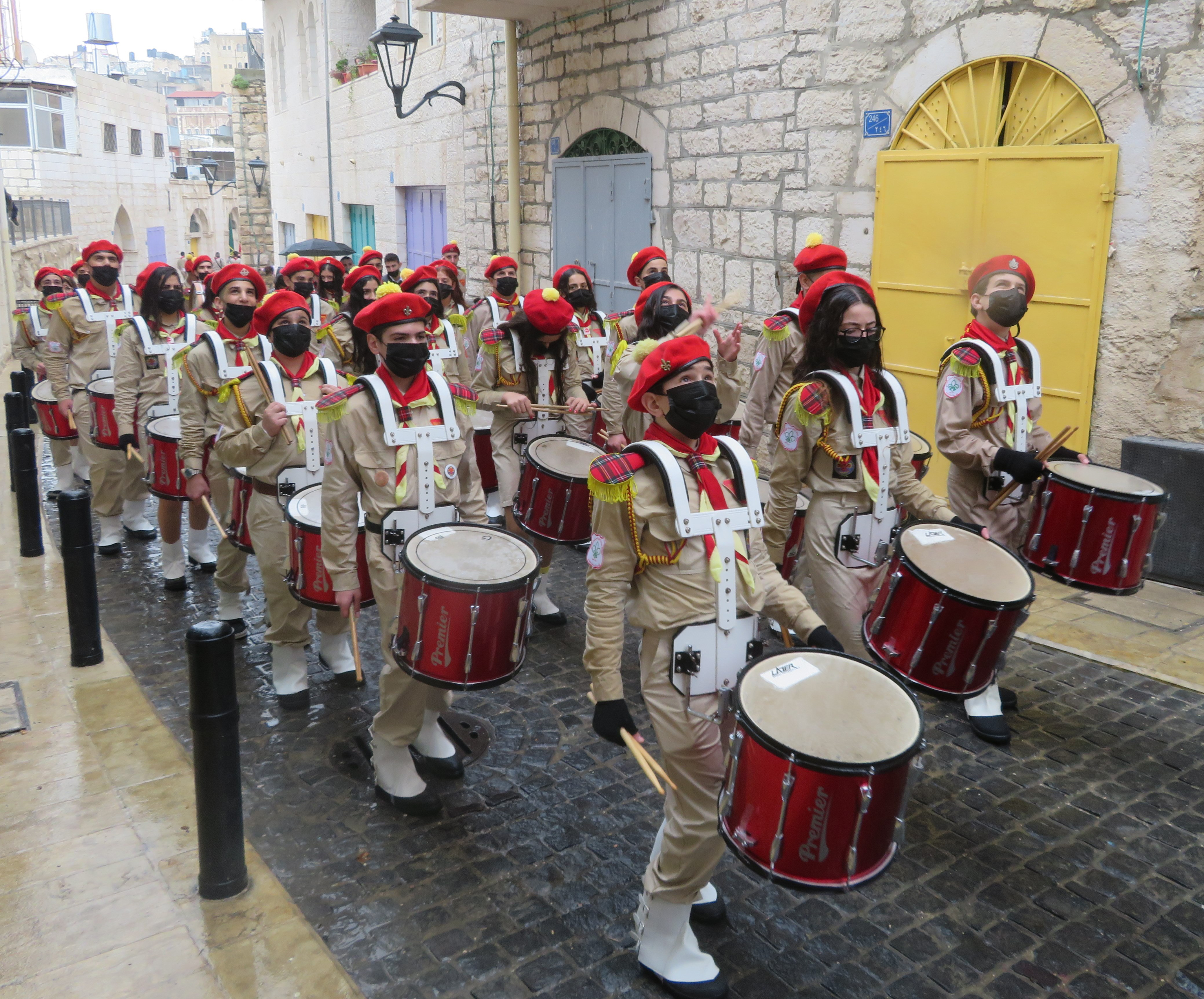 Masked and marching: Palestinian scout troops on Christmas Eve morning in Bethlehem.