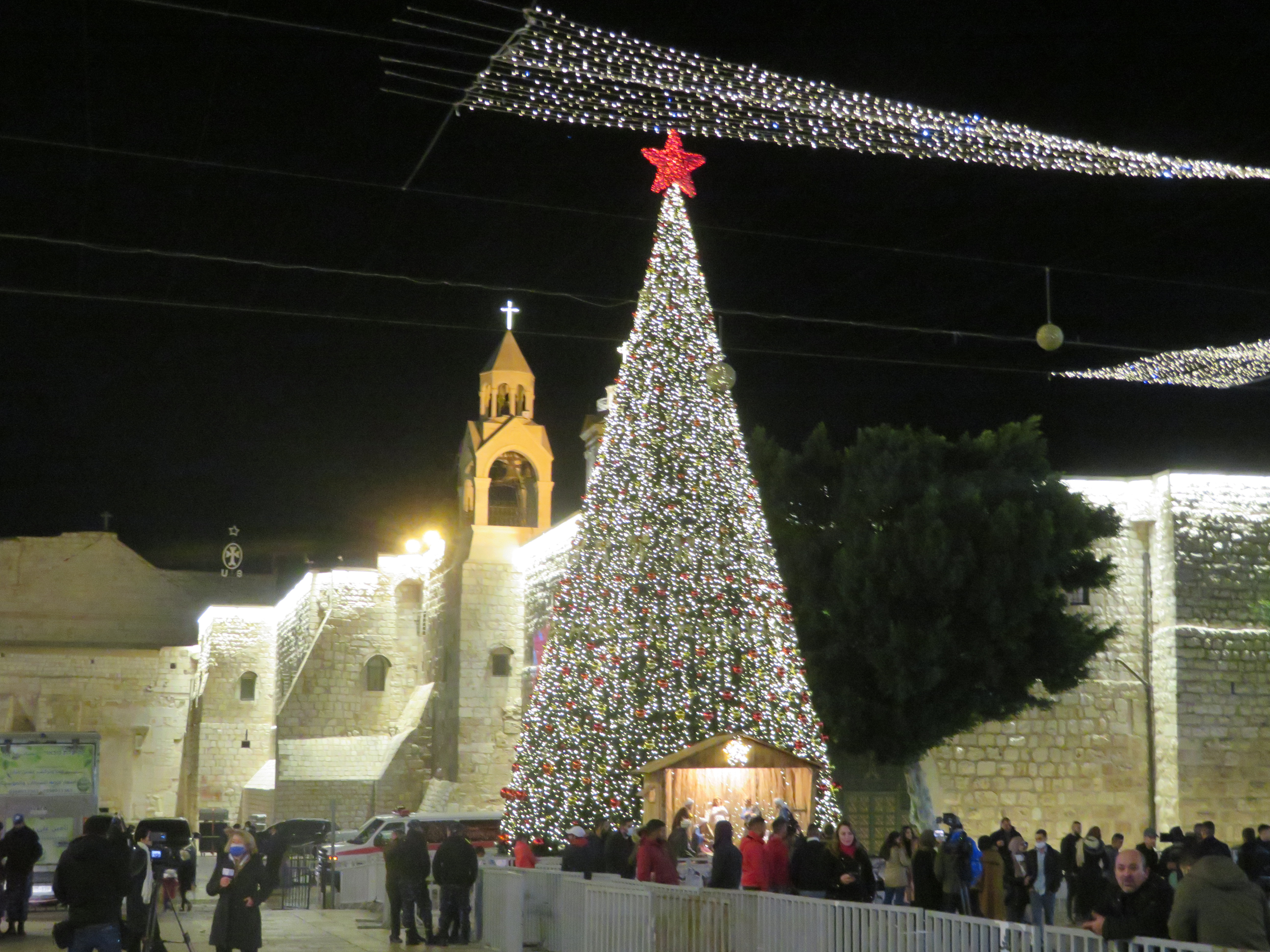 A COVID Christmas: A smaller than usual crowd in Bethlehem's Manger Square on Christmas Eve, 2020
