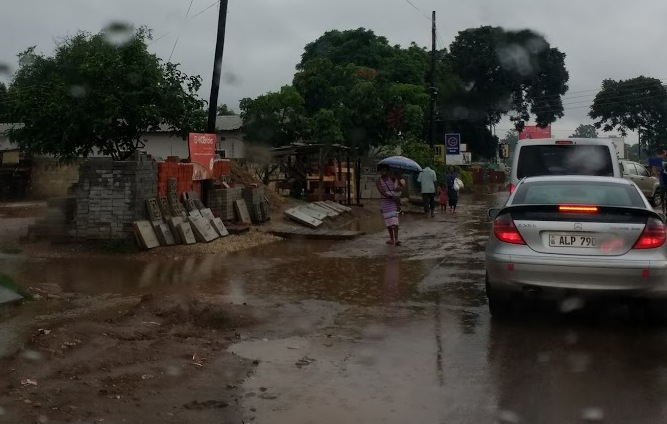 Rainy season regularly brings flooding to Lusaka's roads and walkways.