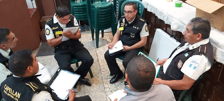 Chaplains of the National Civil Police Force of Guatemala (PNC) preparing to enter the Men in the Mirror training.