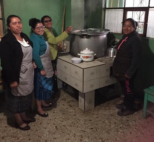 Women preparing chicken stew