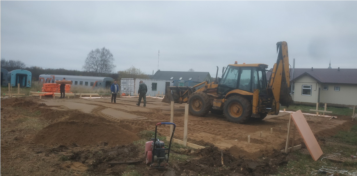 Construction of new community health center in Davydovo is underway. Heavy machinery is being utilized.